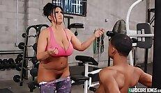 Young black cock fucks huge natural tits MILF at gym