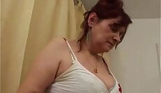 Busty hairy granny gets pussy banged