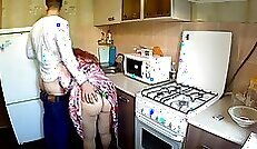 Anal strapon fuck in the kitchen by lucky mom in red fishnets