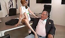 redhead that has nice looking tits is getting anal fucked